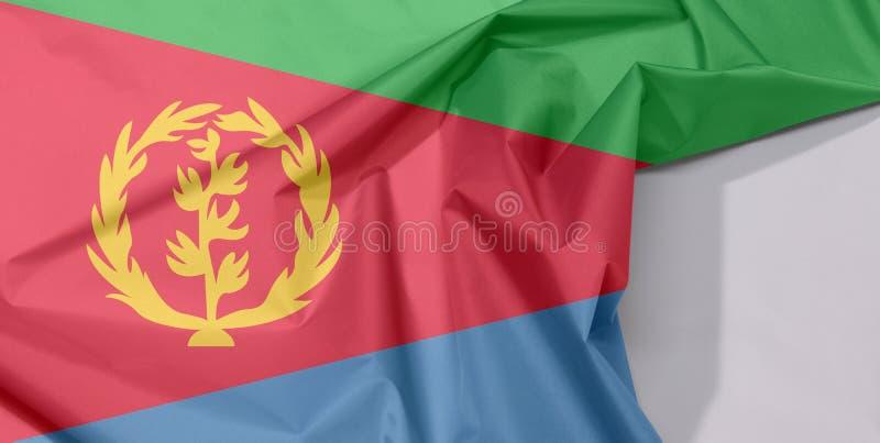Crepe e vinco da bandeira da tela de Eritreia com espaço branco imagem de stock