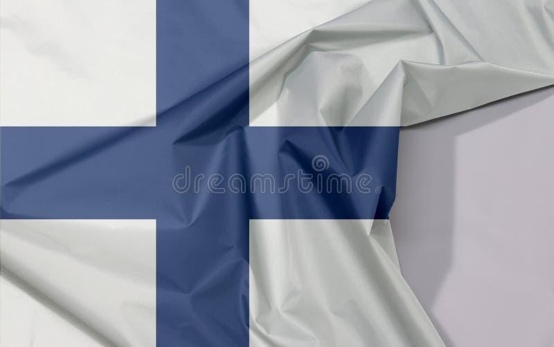 Crepe e vinco da bandeira da tela de Finlandia com espaço branco foto de stock