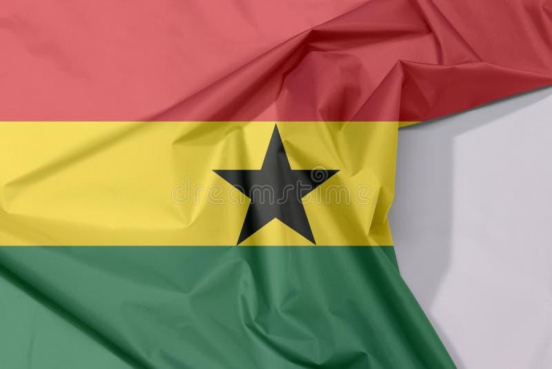 Crepe e vinco da bandeira da tela de Gana com espaço branco imagem de stock royalty free