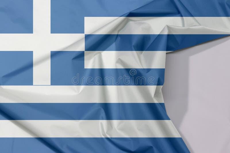 Crepe e vinco da bandeira da tela de Grécia com espaço branco fotografia de stock royalty free
