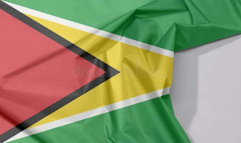 Crepe e vinco da bandeira da tela de Guiana com espaço branco fotografia de stock royalty free
