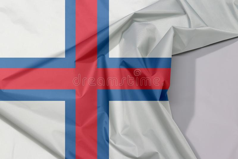 Crepe e vinco da bandeira da tela de Ilhas Faroé com espaço branco imagem de stock royalty free