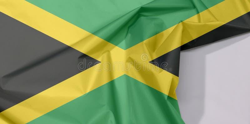 Crepe e vinco da bandeira da tela de Jamaica com espaço branco fotos de stock royalty free