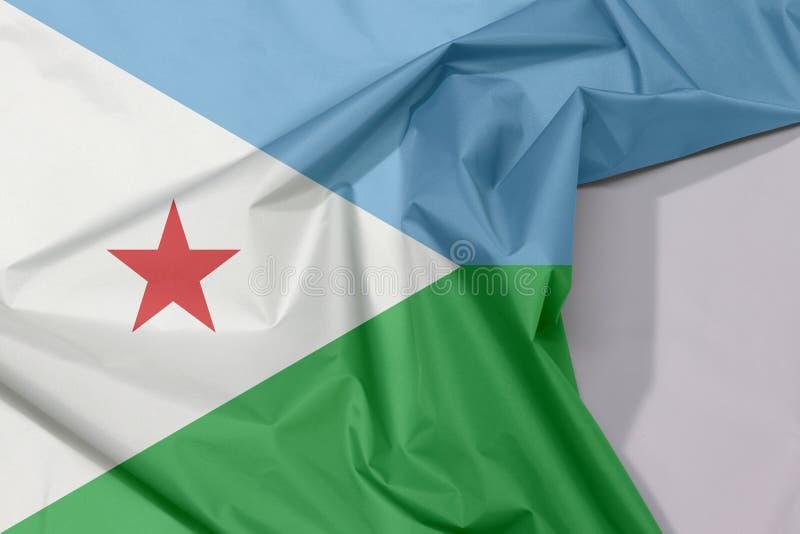 Crepe e vinco da bandeira da tela de Jibuti com espaço branco imagem de stock