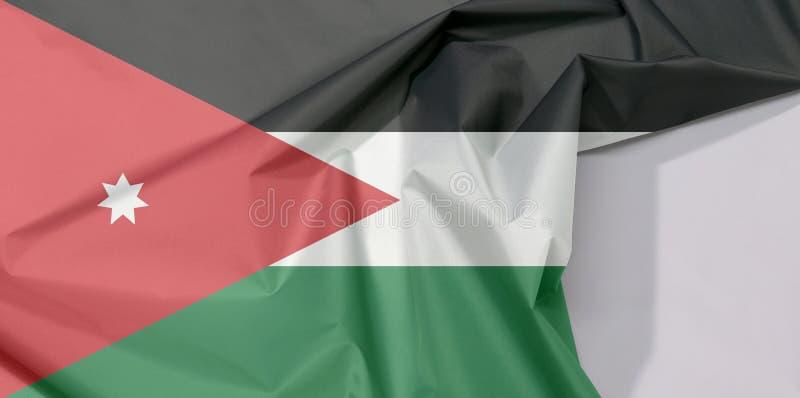 Crepe e vinco da bandeira da tela de Jordânia com espaço branco imagem de stock