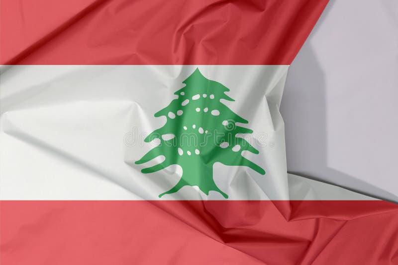 Crepe e vinco da bandeira da tela de Líbano com espaço branco fotos de stock royalty free