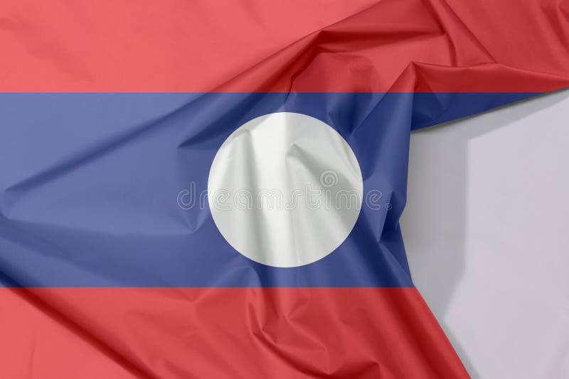 Crepe e vinco da bandeira da tela de Laos com espaço branco imagens de stock royalty free