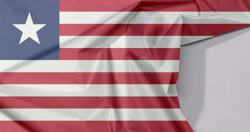 Crepe e vinco da bandeira da tela de Libéria com espaço branco fotos de stock royalty free