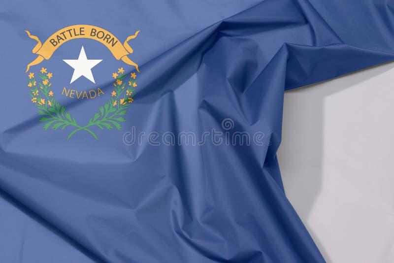 Crepe e vinco da bandeira da tela de Nevada com espaço branco foto de stock