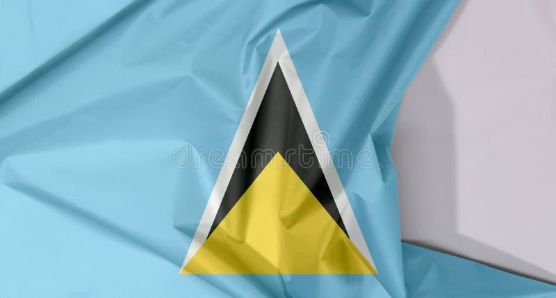 Crepe e vinco da bandeira da tela de St Lucia com espaço branco imagens de stock royalty free
