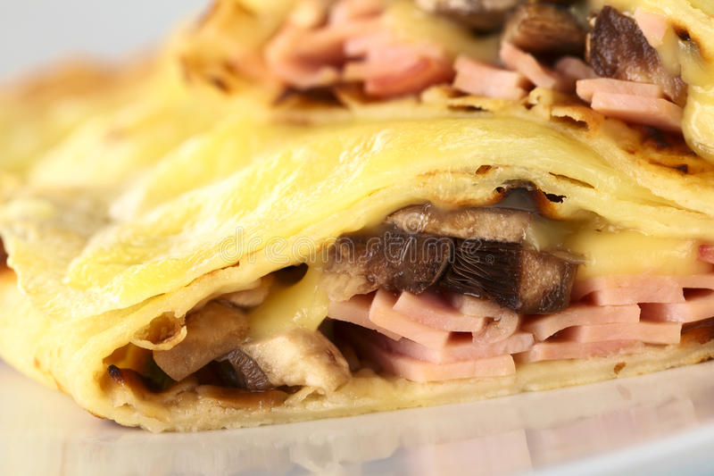 Crepe Filled with Ham, Cheese and Mushroom stock images