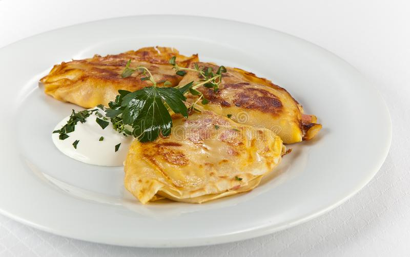 Crepe with ham and sheese. On dish royalty free stock photos