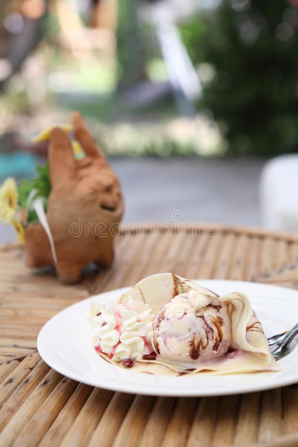 Crepe with ice cream. On a plate stock photo