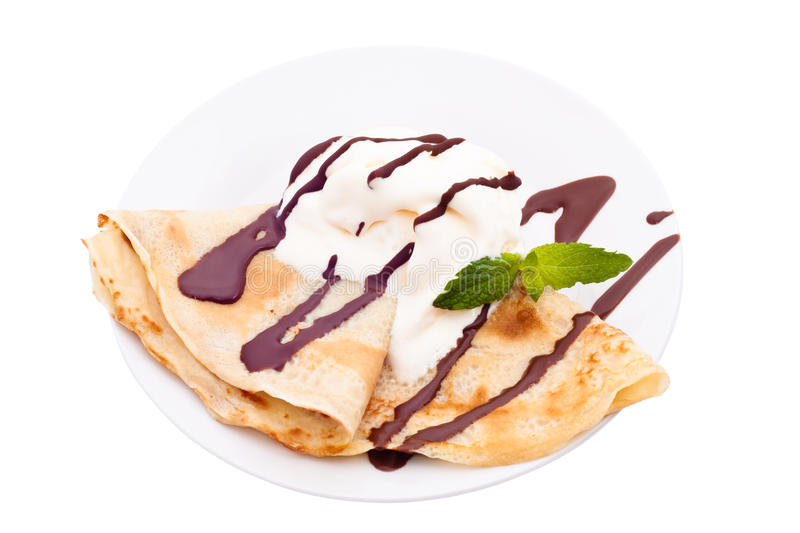 Crepe with ice cream and chocolate topping. Isolated on white background. A crepe is a type of very thin pancake. It is very popular in France. Crepe may stock photo