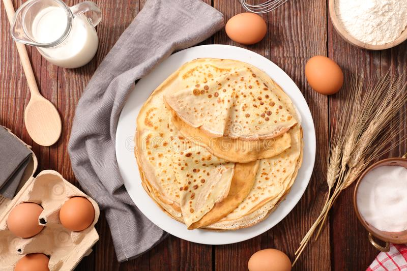 Crepe with ingredient. On wood background stock images