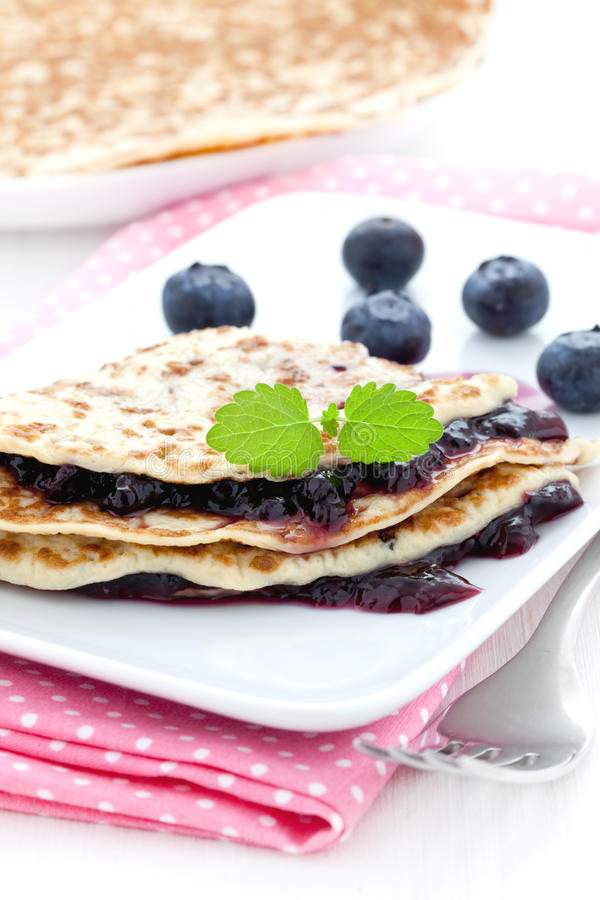 Crepe with jam. Fresh crepe with bilberry jam royalty free stock photography