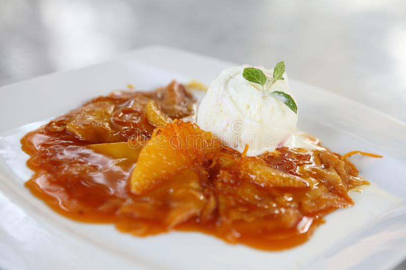 Crepe with orange sauce and ice cream stock images