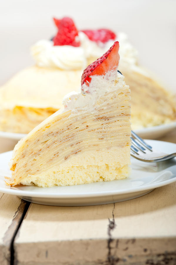 Crepe pancake cake. With whipped cream and strawberry on top stock photography