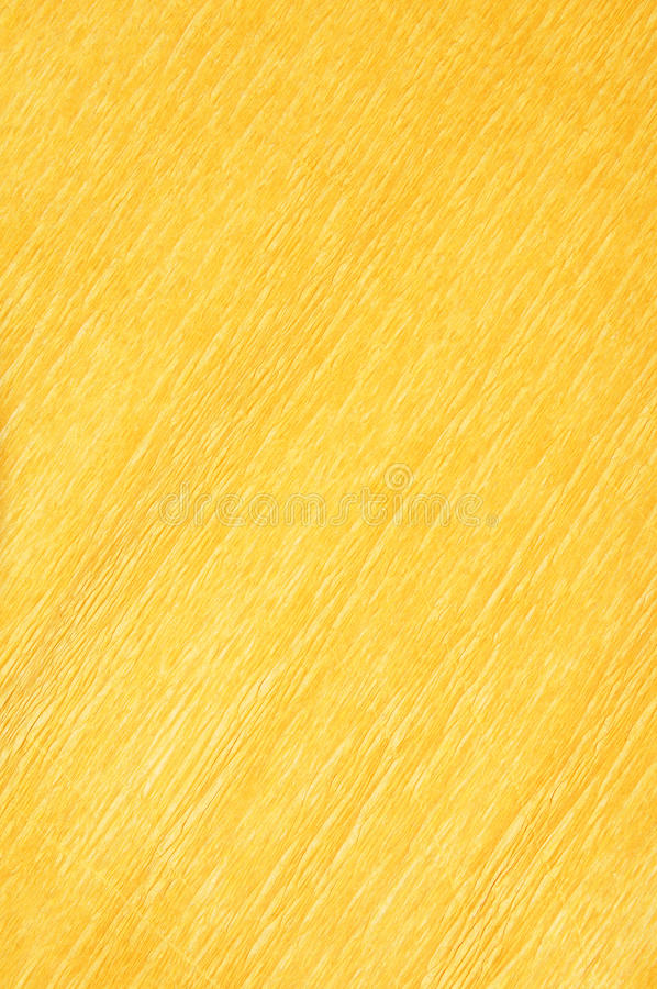 Crepe paper. Yellow crepe paper texture background royalty free stock photos