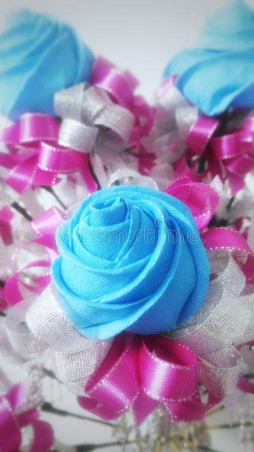 Crepe paper roses doorgift stock images