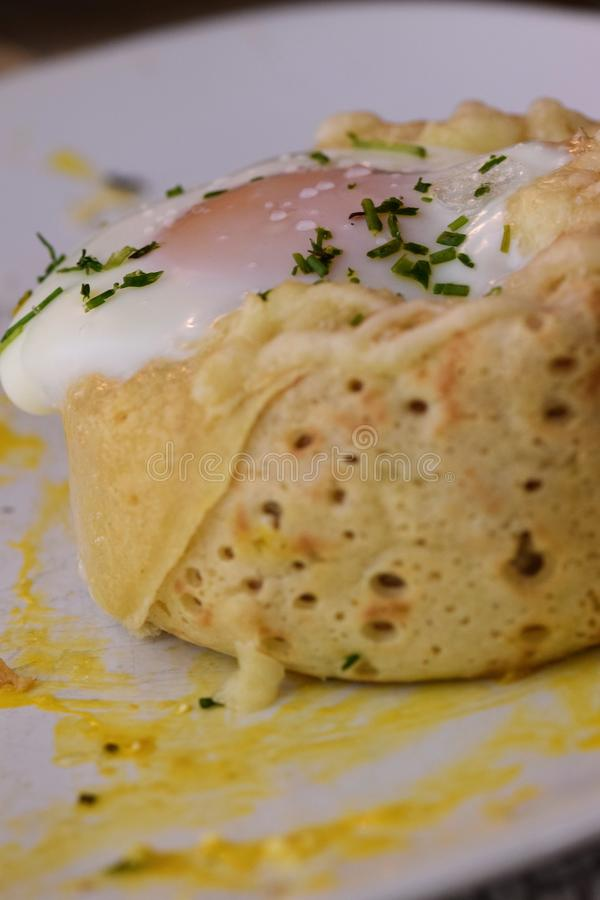 Crepe rolls. Stuffed with spinach, mushrooms, goat cheese and topped with an egg...home made tasty food egghome stock image