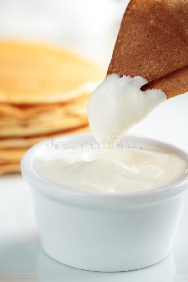 Crepe with sour cream royalty free stock image
