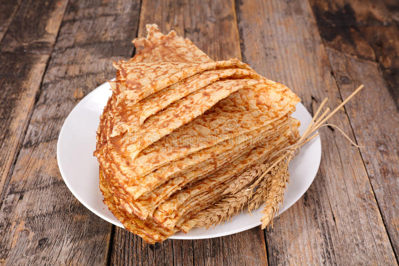 Crepe. Stack of crepe on wood royalty free stock photo