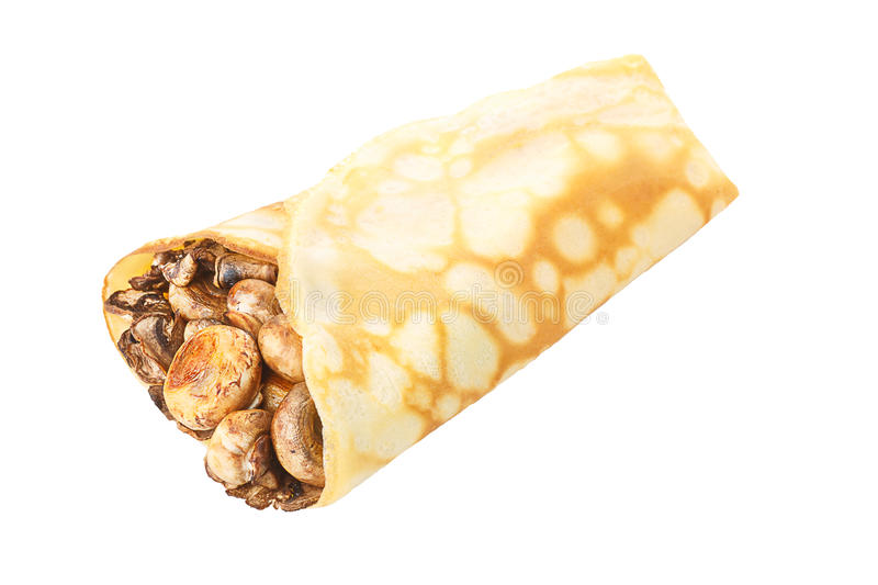 Crepe stuffed with mushrroms. Elegant, neat,hearty crepe stuffed with champignons isolated on white shadowless royalty free stock photo