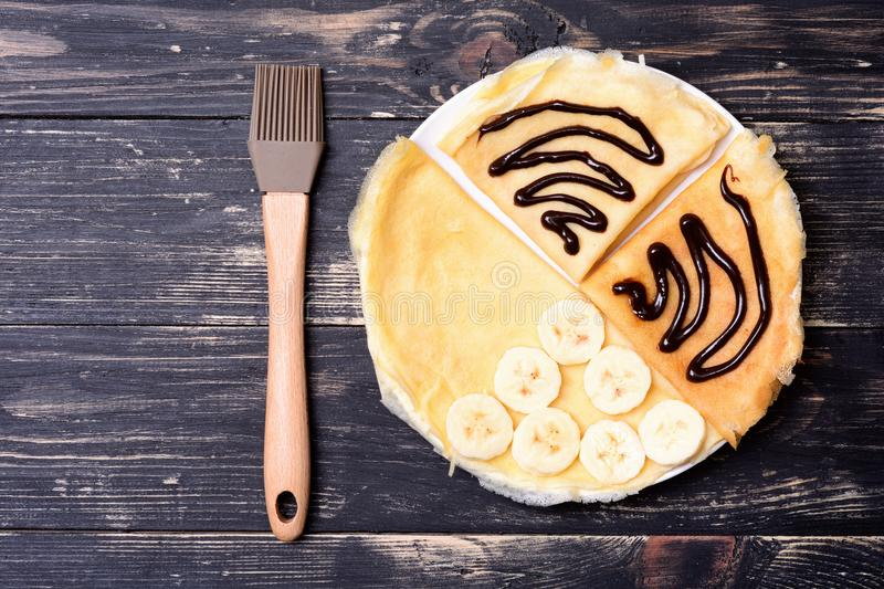 Crepes with banana & chokolate stock photography