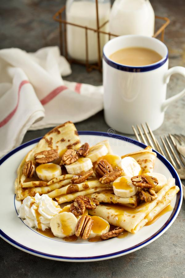 Crepes with bananas and caramel royalty free stock images