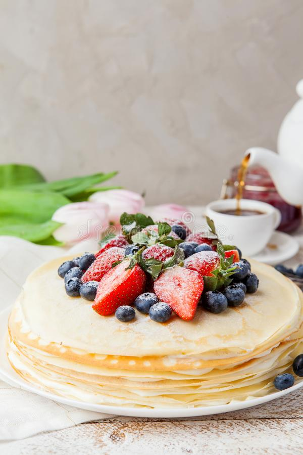 Crepes cake with cottage cheese and strawberry, selective focus. Homemade crepes cake with strawberry on rustic background. Cooking fresh homemade breakfast stock photo