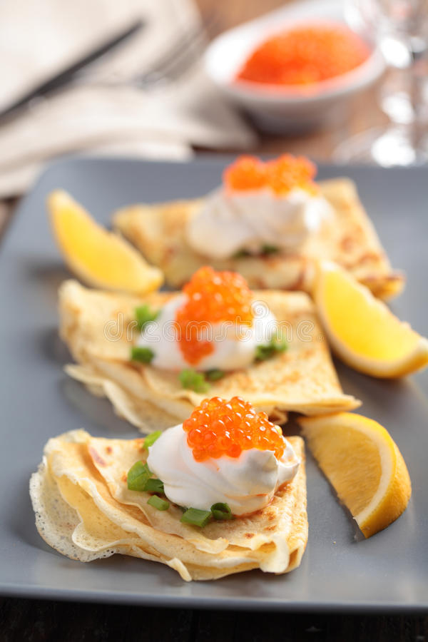 Crepes with caviar royalty free stock images