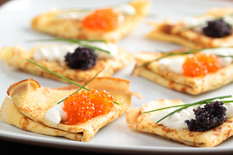 Crepes with caviar royalty free stock photo
