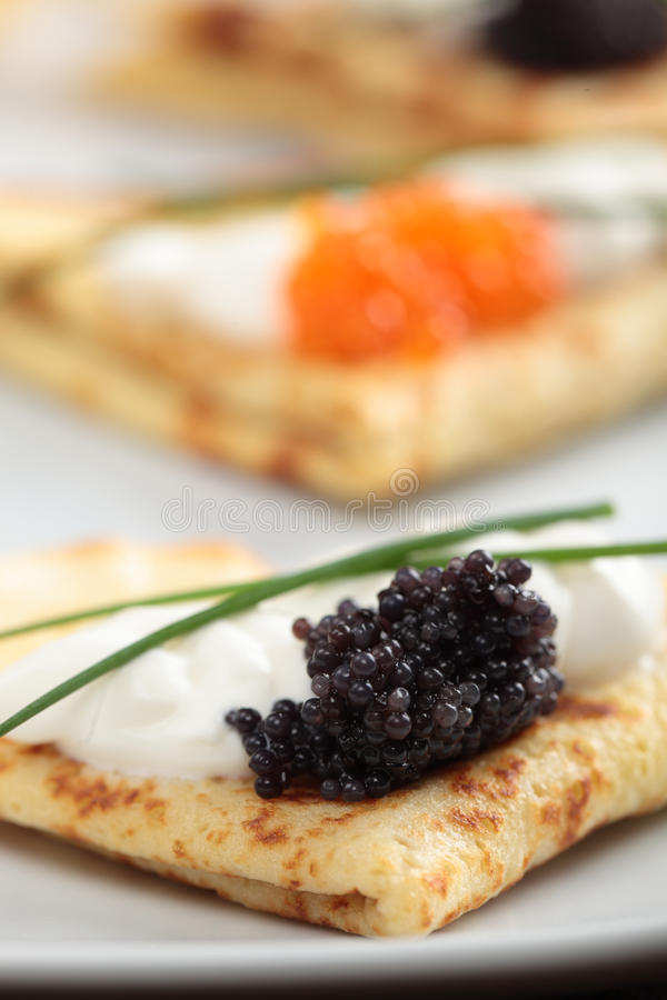 Crepes with caviar stock photography