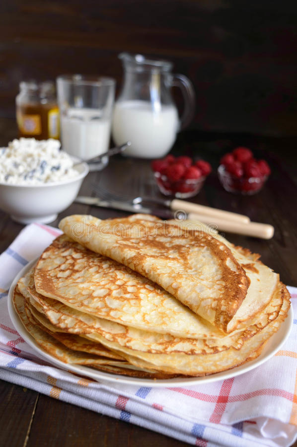 Crepes with cottage cheese. Homemade Crepes for brekfast with milkn royalty free stock image