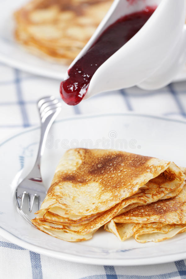 Crepes with cranberry jam royalty free stock photo