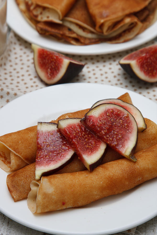 Crepes with figs. Homemade sweet crepes with figs royalty free stock photo
