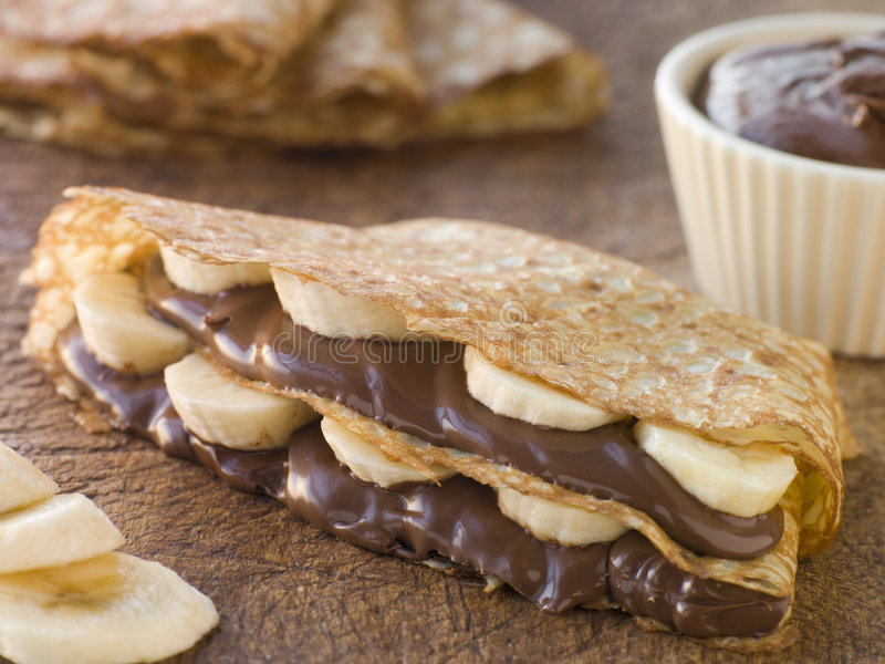 Crepes filled with Banana and Chocolate Hazelnut stock photo