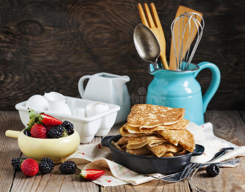 Crepes with fresh raspberry and blackberry. Homemade Crepes with fresh raspberry and blackberry stock image