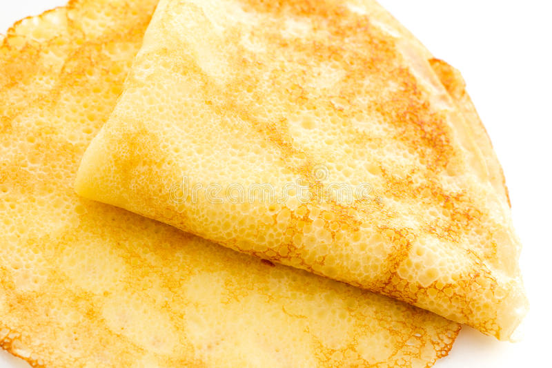 Crepes. Freshly homemade crepes on a white background royalty free stock images