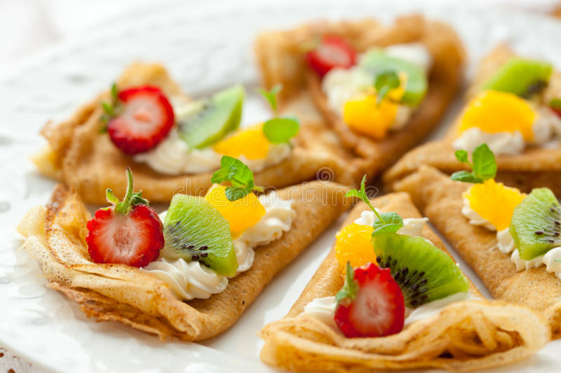 Crepes with fruits stock image