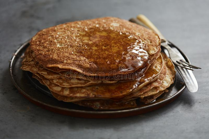 Crepes with maple syrup stock image