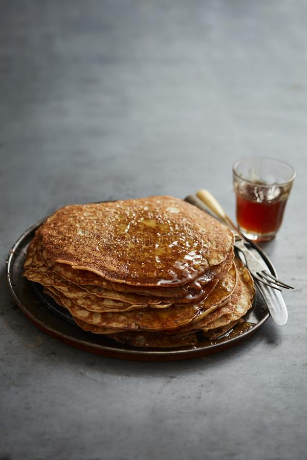 Crepes with maple syrup royalty free stock photo
