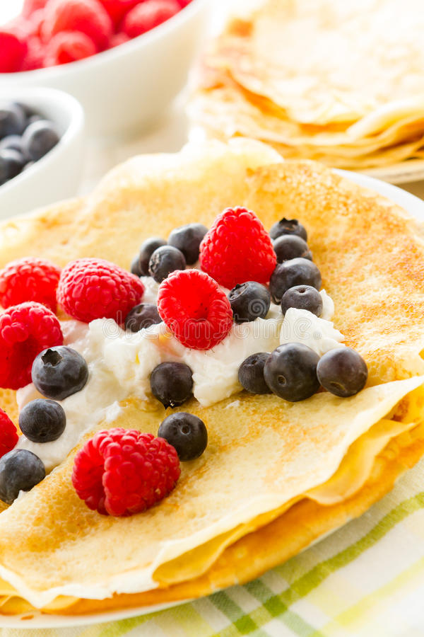 Crepes. Homemade crepes with fresh raspberries and blueberries stock photography