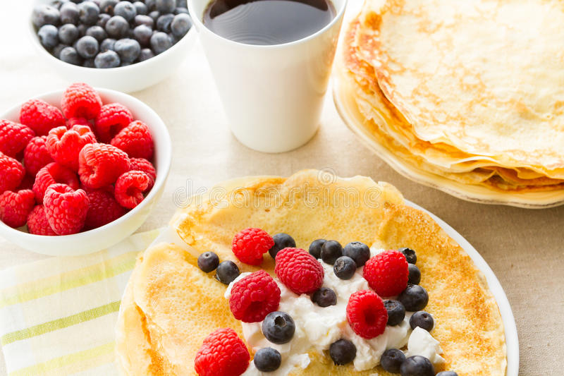 Crepes. Homemade crepes with fresh raspberries and blueberries stock photos