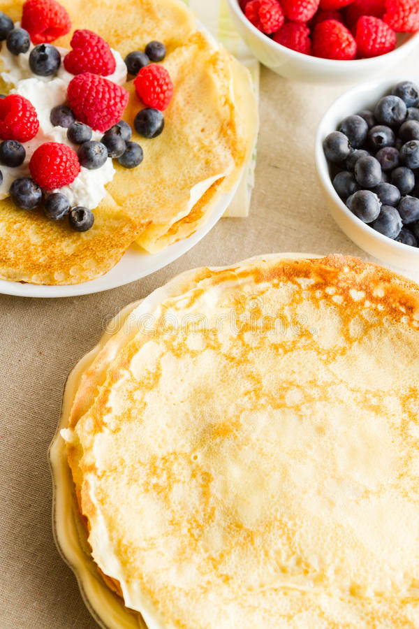 Crepes. Homemade crepes with fresh raspberries and blueberries stock photo