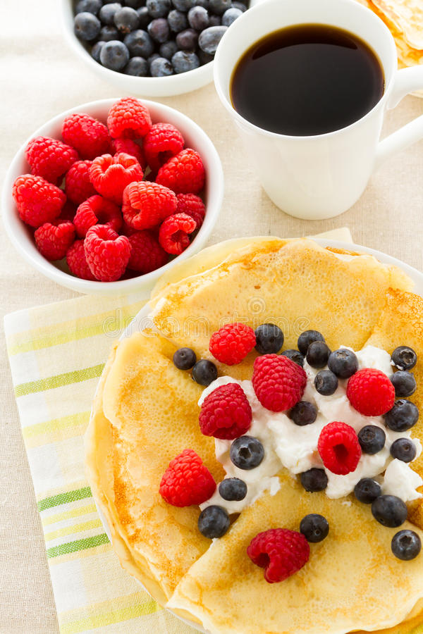 Crepes. Homemade crepes with fresh raspberries and blueberries stock image