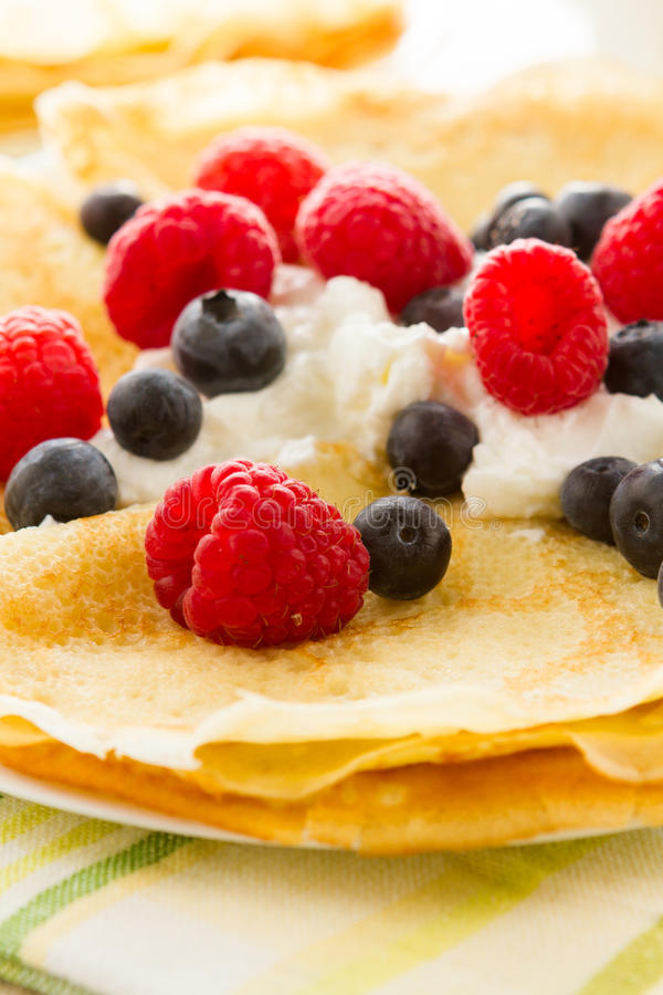 Crepes. Homemade crepes with fresh raspberries and blueberries stock images