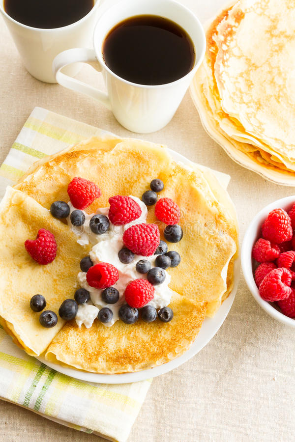 Crepes. Homemade crepes with fresh raspberries and blueberries royalty free stock image