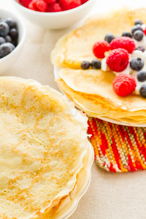 Crepes. Homemade crepes with fresh raspberries and blueberries royalty free stock photo